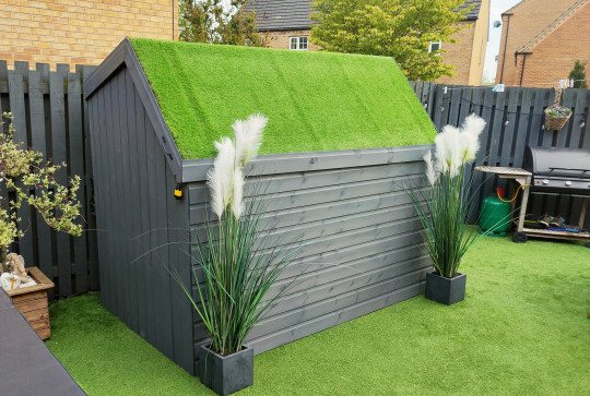 RICHARD WARD / CATERS NEWS (PICTURED- The ordinary shed) - A dad had built an ordinary shed in his garden which transforms into a secret cocktail bar. Dad-of-three, Richard Ward, from Dinnington, Sheffield, built an unassuming shed in his back garden which has a removable roof. After deciding to build a bar, the 51-year-old decided he wanted it to resemble an ordinary shed for enhanced security and not to attract burglars. But when the roof of the discreet bar opens up, the trendy cocktail bar is uncovered and its height increases to over 7ft with ample space for two people to stand inside. - SEE CATERS COPY