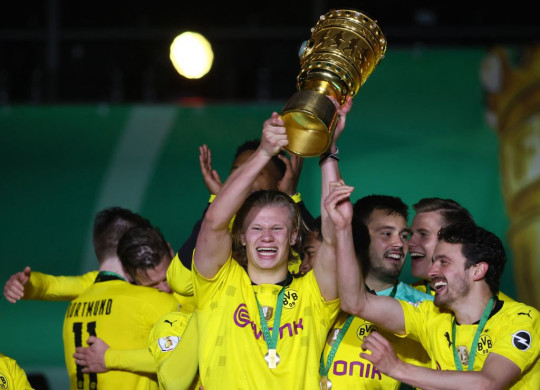 Erling Haaland celebrates with the German Cup