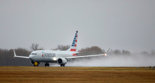 An American Airlines Boeing 737 Max takes off at Tulsa International Airport to fly to Dallas Wednesday, Dec. 2, 2020 in Tulsa, Okla.. Earlier the plane had flown a group of journalists and American Airlines employees from Dallas to the American Airlines Tulsa maintenance facility. (Mike Simons/Tulsa World via AP)