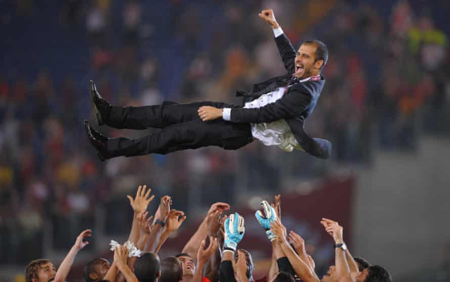Pep Guardiola is tossed in the air by his Barcelona players after victory over Manchester United in the 2009 Champions League final.
