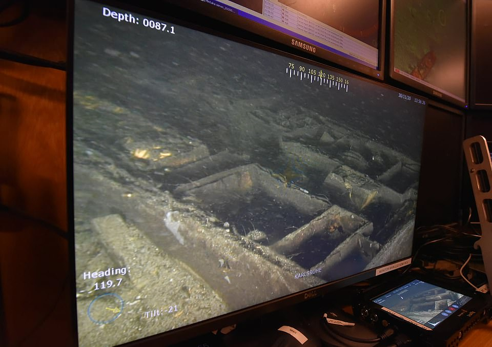 Underwater discoveries: Baltic divers say they found chests and other items and will continue their search in April as they examine whether the wreck of the Karlsruhe could answer the decades-old question of what happened to the Amber Room