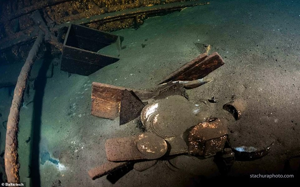 Artefacts were found buried underneath sand inside the ship at the bottom of the Baltic Sea as treasure hunters look for the long-lost Amber Room