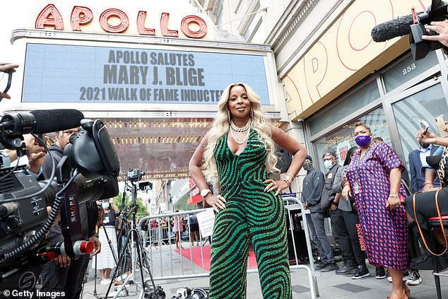 Trendy:The low-cut halter top showed off Blige's ample cleavage and toned tattooed arms. She was also sporting a huge gold chain necklace and a strand of pearls