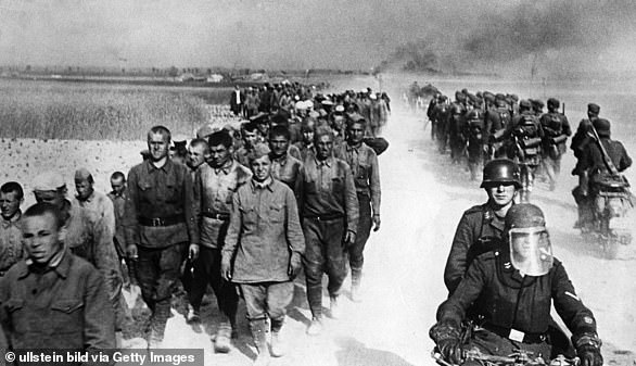 German troops march captured Russian soldiers to camps during Operation Barbarossa in June 1941