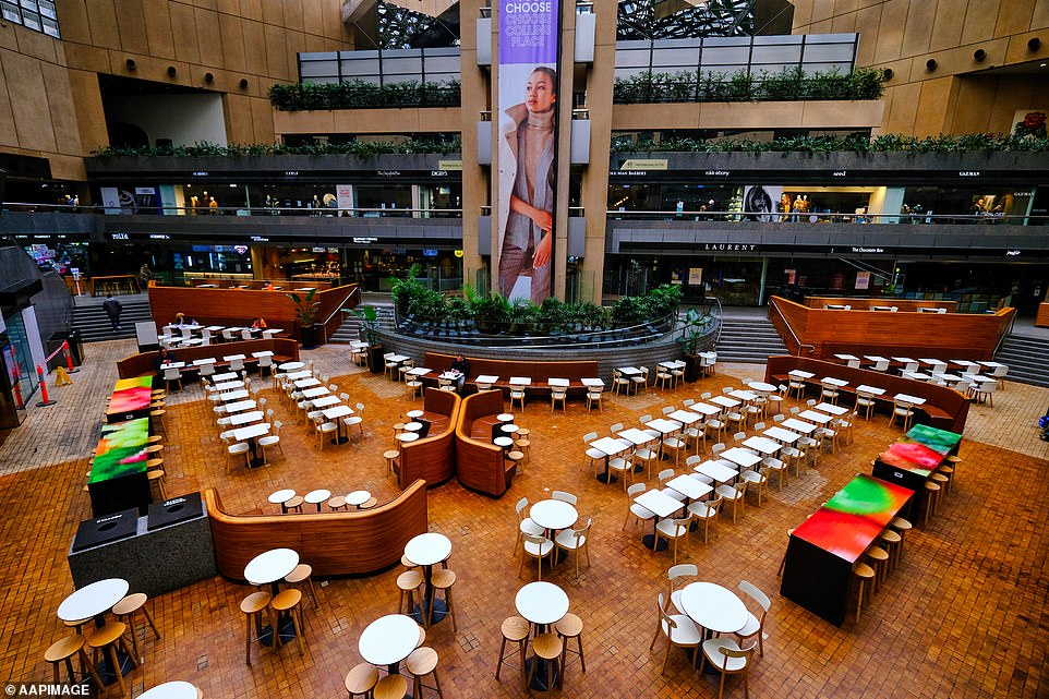 Empty dining tables are seen at Collins place in Melbourne today
