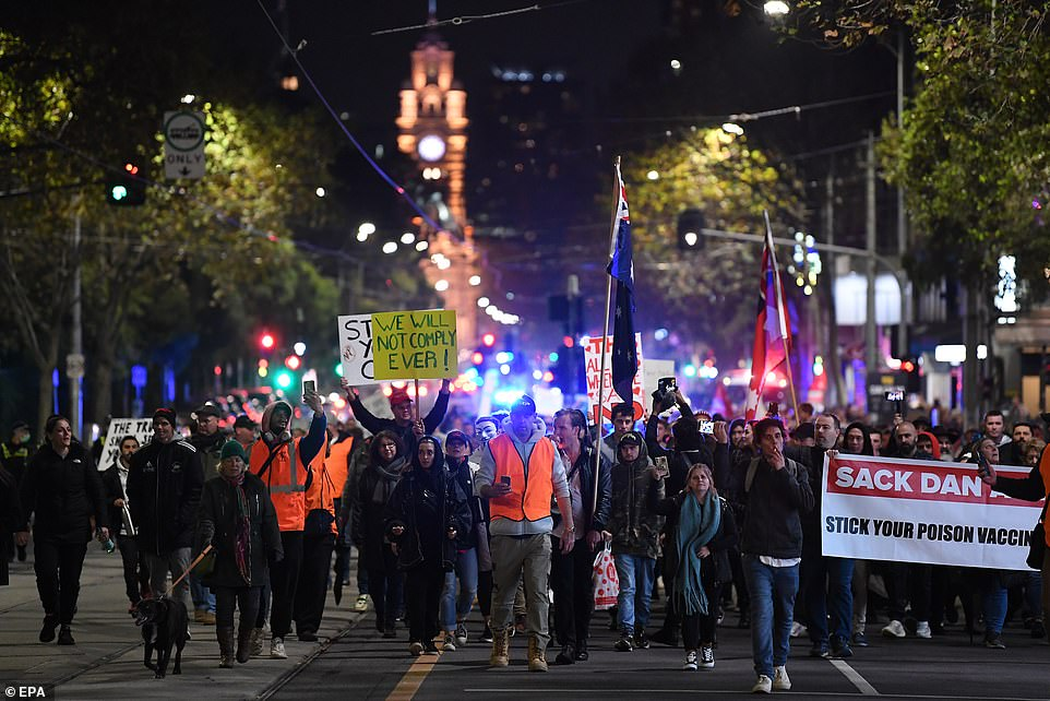 Anti-lockdown Protesters (pictured on Thursday night) gathered at Flinders Street Station before storming the streets to spread their message, demanding Daniel Andrews is sacked