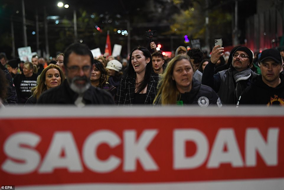 Anti-lockdown protesters gather outside of the Victorian State Parliament in Melbourne on Thursday, hours ahead of the restrictions being imposed