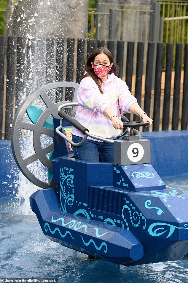 Enjoying the ride: Giovanna looked to be having a great time as she controlled her cart in the new water ride