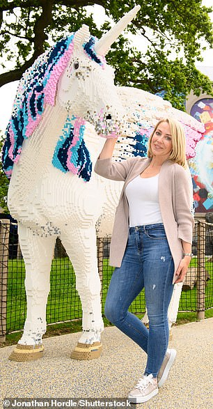 In one picture, Laura was seen standing next to a giant Lego sculpture of a unicorn