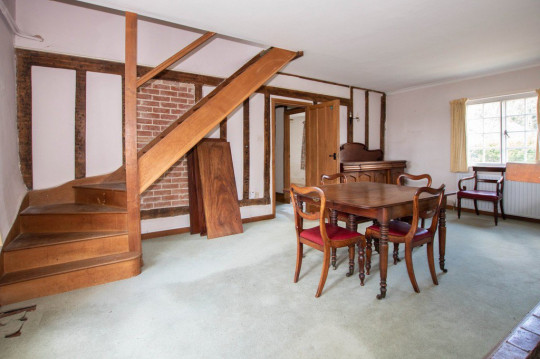 BNPS.co.uk (01202) 558833. Pic: Cheffins/BNPS Pictured: Dining room. The perfect home for a recluse? A historic moated farmhouse that has not been sold for half a century is up for auction with a guide price of ?600,000. Grade II listed Parsonage Farm is an English Heritage scheduled monument and is believed to be built on the site of an iron age fort. The house dates back to the 15th century and, having been in the same family for the past 50 years, is now in need of modernisation. But once renovated it could be worth ?1.2m - double its current price tag.