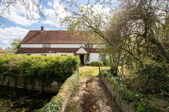 BNPS.co.uk (01202) 558833. Pic: Cheffins/BNPS Pictured: Bridge over the moat. The perfect home for a recluse? A historic moated farmhouse that has not been sold for half a century is up for auction with a guide price of ??600,000. Grade II listed Parsonage Farm is an English Heritage scheduled monument and is believed to be built on the site of an iron age fort. The house dates back to the 15th century and, having been in the same family for the past 50 years, is now in need of modernisation. But once renovated it could be worth ??1.2m - double its current price tag.
