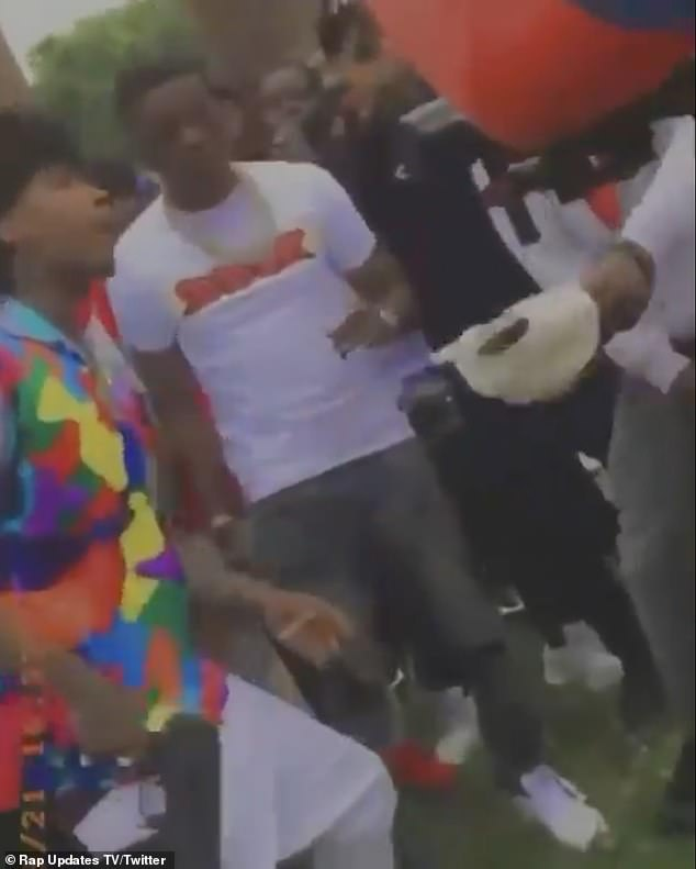 Unharmed: Boosie (pictured in a white T-shirt) was unharmed and sources told TMZ that he is not suspected of carrying out the shooting