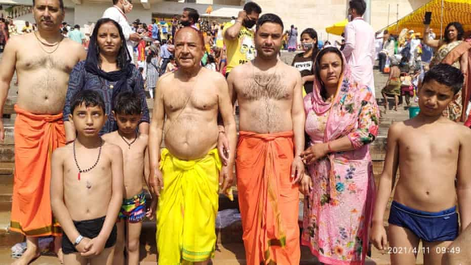 Thakur Puran Singh, in Yellow, standing on the bank of Ganges with his family during Kumbh