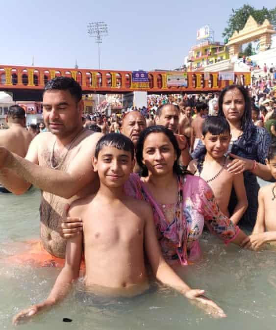 Family of Thakur Puran Singh in the Ganges during Kumbh
