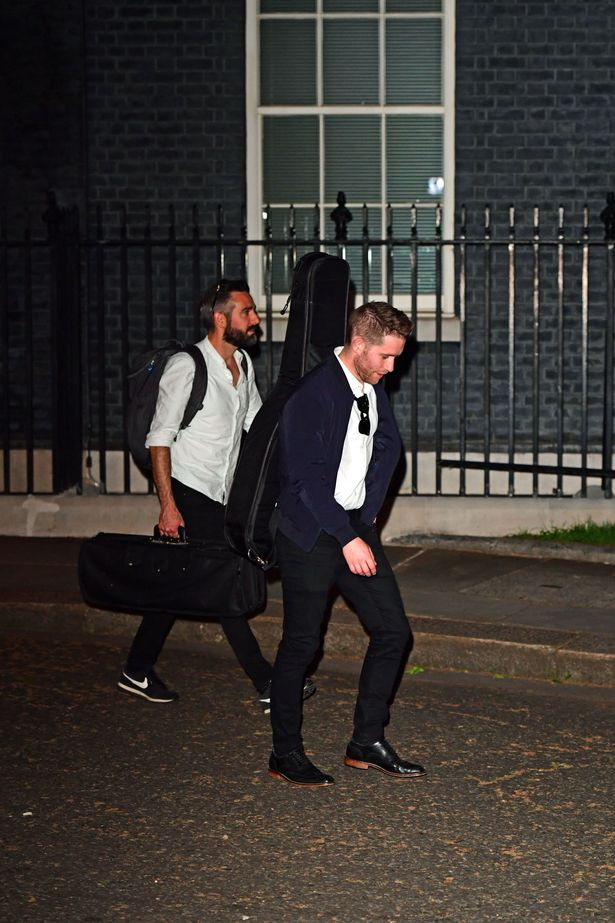 People carrying musical instruments leave 10 Downing Street