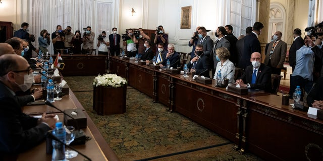Israeli Foreign Minister Gabi Ashkenazi, third right, with Egyptian Foreign Minister Sameh Shoukry (not shown), during high-level talks to shore up a fragile truce between Israel and the Hamas militant group at the Tahrir Palace in Cairo, Egypt, Sunday, May 30, 2021. (AP Photo/Nariman El-Mofty)
