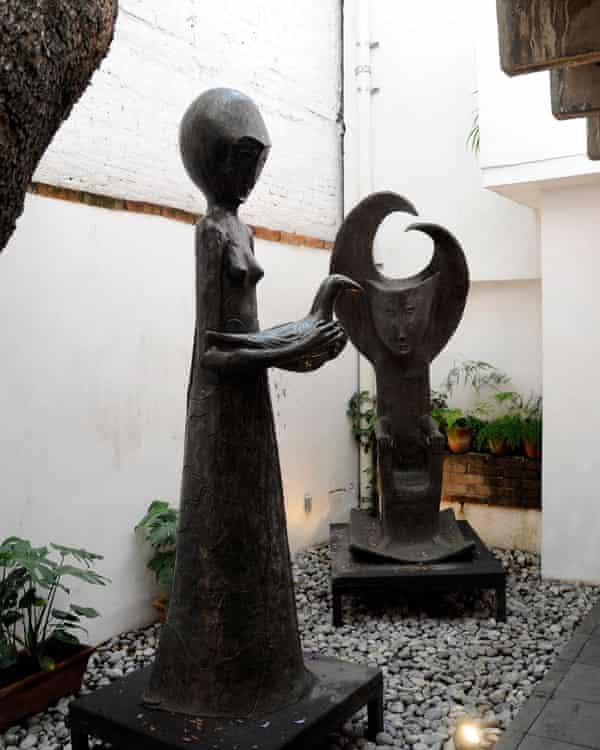 The most exotic of the 1940s artist-émigrés … Carrington's courtyard, featuring her sculpture Woman with Pigeon.
