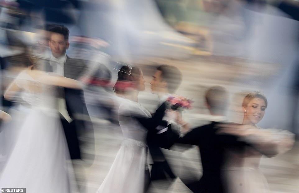 After the clock strikes twelve, attendees perform the famous Russian midnight quadrille - a dance that was fashionable in late 18th- and 19th-century Europe.It is followed by tango, foxtrot, jive, quick-step, cha-cha-cha, and rumba into the small hours