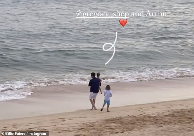 Making memories:And as the sun began to set, Greg carried Arthur during a stroll along the waterline, with Billie capturing the sweet moment