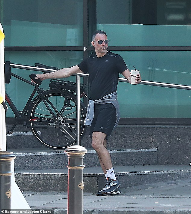 Casual:Ryan opted for a laid back look for the day, sporting a black T-shirt with matching shorts and grey trainers
