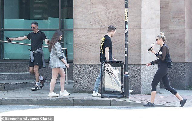 Couple:Zara walked behind her boyfriend as they made their way towards his car following the fitness class