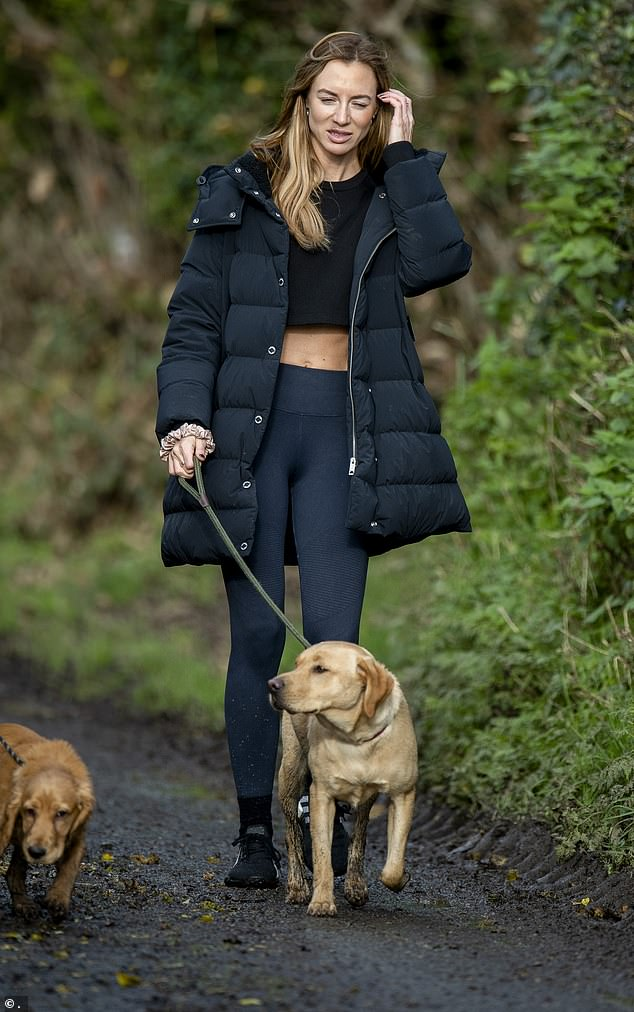 Absent: Greville seen walking her dog in November 2020. She was not in court, nor was her sister, who Ryan is also accused of attacking