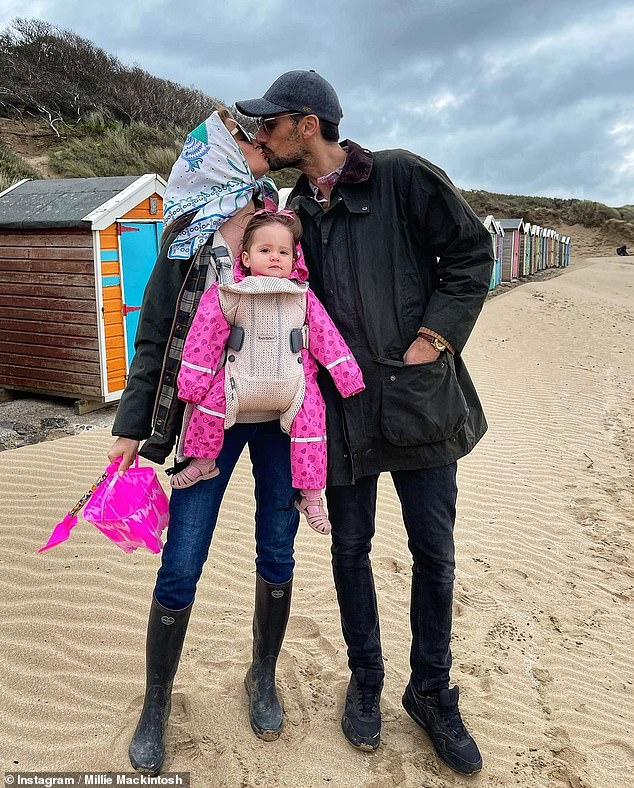 Baby's first beach trip! Millie looked effortlessly chic as she enjoyed a family trip to the seaside in Devon with husband Hugo and daughter Sienna on Tuesday