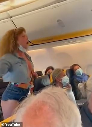 The woman lashed out at flight crew as she was dragged off the plane