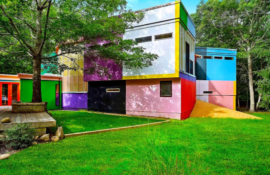 The outside of the property, showing some of the many colours