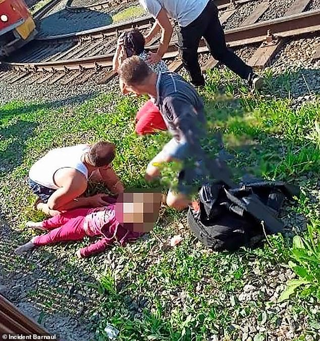 Two girls were thrown over a metal fence onto tram tracks and are both in a serious condition. Vike, four, sustained a skull fracture and wounds to her lungs and stomach