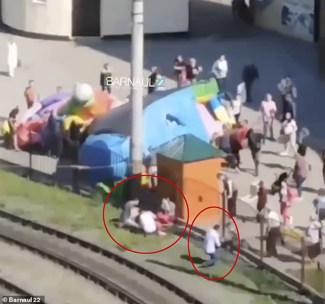 The girls' parents scrambled over the fence to help their injured children after the bouncy castle they were playing on 'exploded'