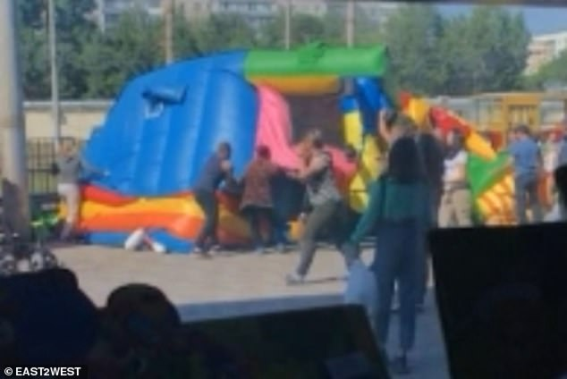 One theory was that the bouncy castle had been overinflated and then not properly secured but witnesses also said the castle had no protective underlay, meaning it was rubbing against the tarmac before the sudden 'explosion'