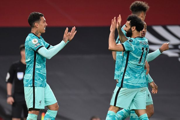 Mohamed Salah congratulates Roberto Firmino after the Brazilian scored Liverpool's third