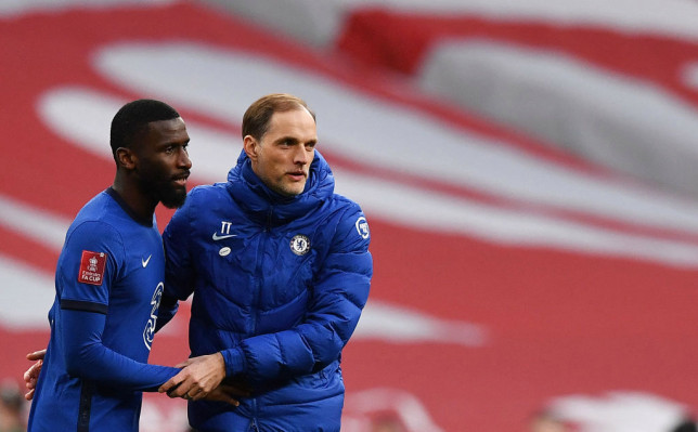 Chelsea's German head coach Thomas Tuchel (R) celebrates with Chelsea's German defender Antonio Rudiger after the English FA Cup semi-final football match between Chelsea and Manchester City at Wembley Stadium in north west London on April 17, 2021.