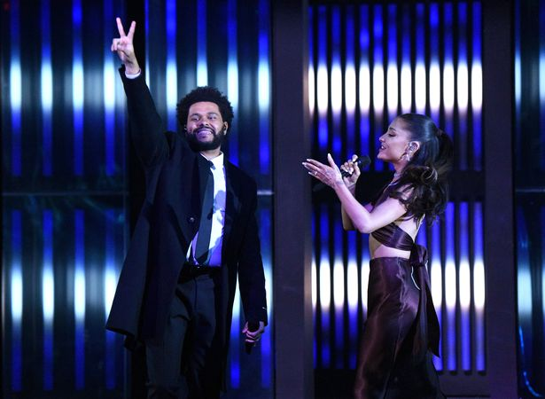 Ariana Grande joined The Weeknd on star during Thursday's award ceremony in Los Angeles