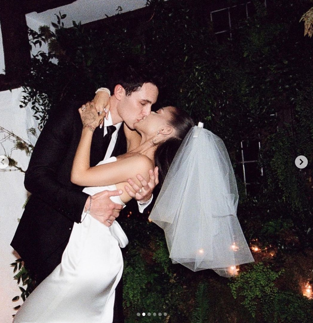 Ariana Grande and husband Dalton Gomez kissing on their wedding day.