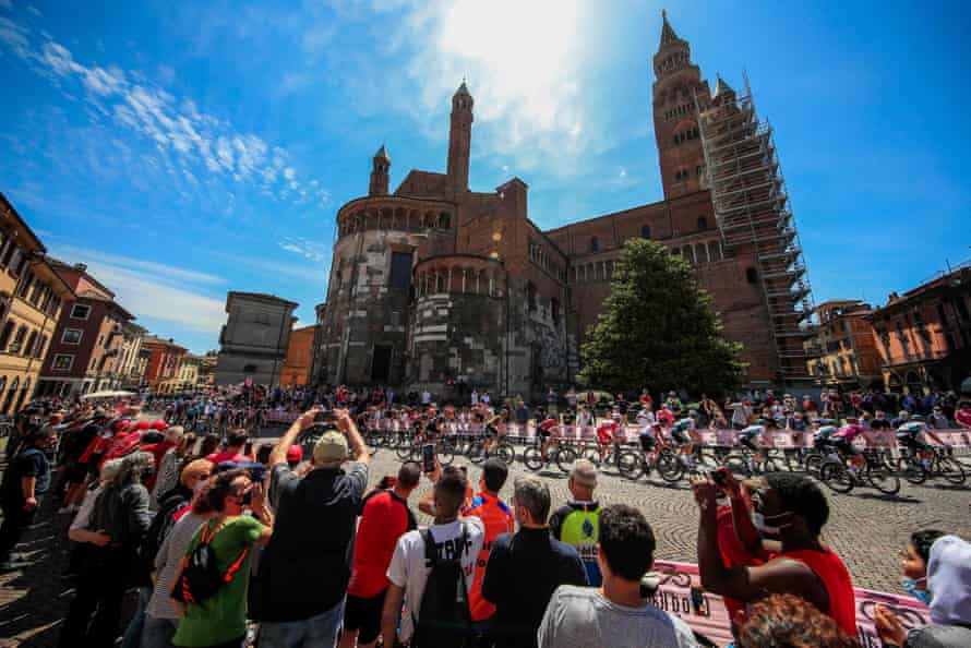 Spectators cheer riders as they pass through Cremona.