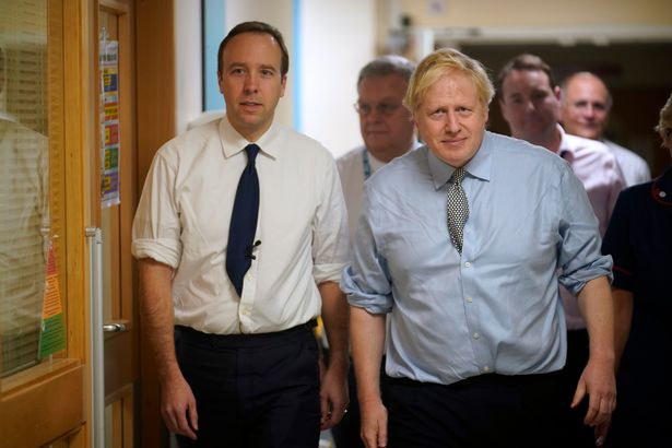 Boris Johnson and Matt Hancock visit a hospital together (file photo)