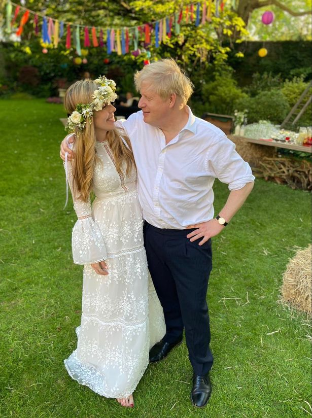 Boris Johnson and Carrie Symonds pose for a photo following their secret wedding