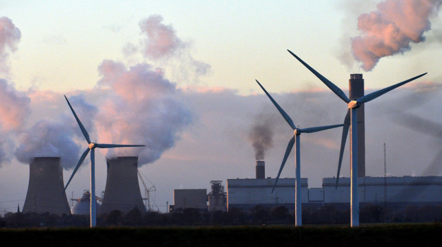 Onshore Wind Farm Turbines Next To The Coal Fired plant