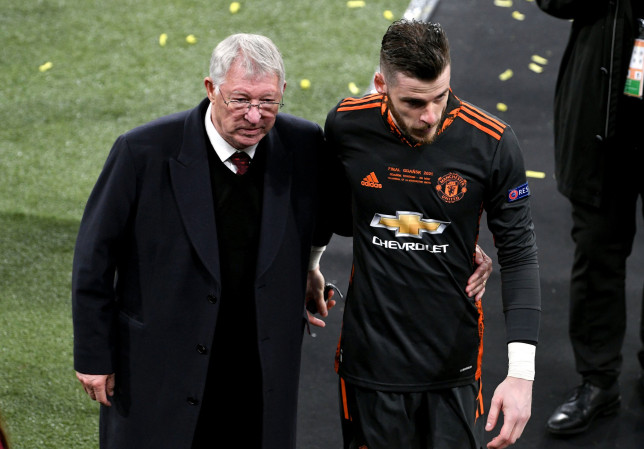 Manchester United goalkeeper David de Gea is consoled by former Manchester United manager Sir Alex Ferguson during the UEFA Europa League final, at Gdansk Stadium, Poland. Picture date: Wednesday May 26, 2021. PA Photo. See PA story SOCCER Final. Photo credit should read: Rafal Oleksiewicz/PA Wire. RESTRICTIONS: Use subject to restrictions. Editorial use only, no commercial use without prior consent from rights holder.