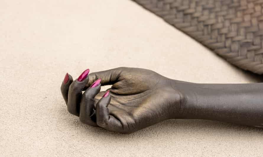 Shavasana I and Shavasana II are bronze figures of Black women underneath woven yoga mats.
