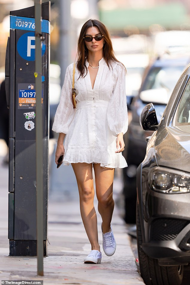 Summer sunshine: Emily Ratajkowskiwas spotted stepping out in Manhattan for a solo stroll wearing a sweet sundress and sneakers on Thursday