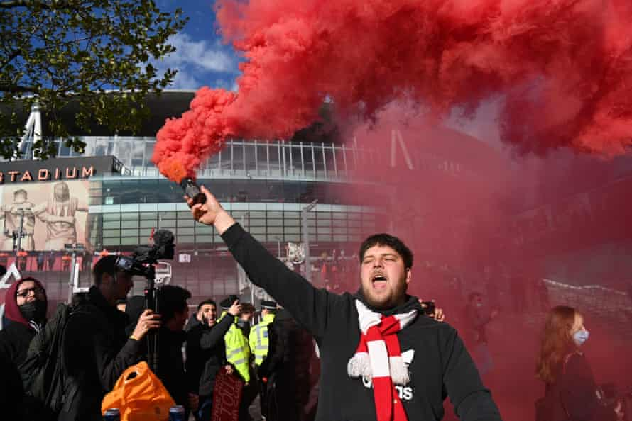 An Arsenal fans protests against owner Stan Kroenke outside the Emirates Stadium
