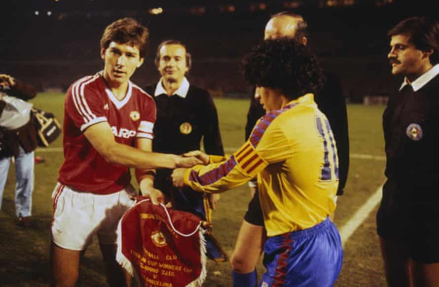 Bryan Robson shakes hands with Diego Maradona before the European Cup Winners' Cup quarter-final second leg in March 1984.