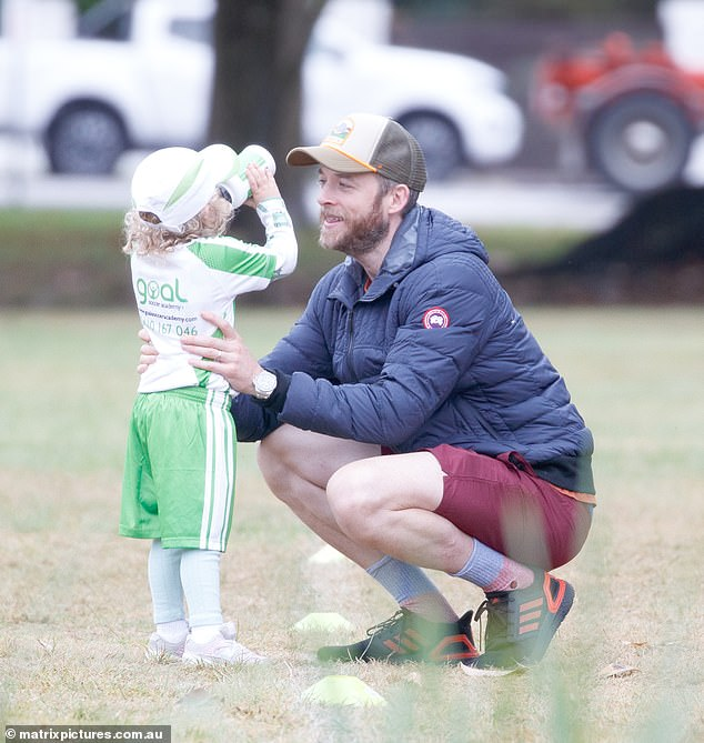 Proud dad!Lego Masters host Hamish Blake looked every inch the doting father on Wednesday as he proudly watched one of his children play soccer in Sydney