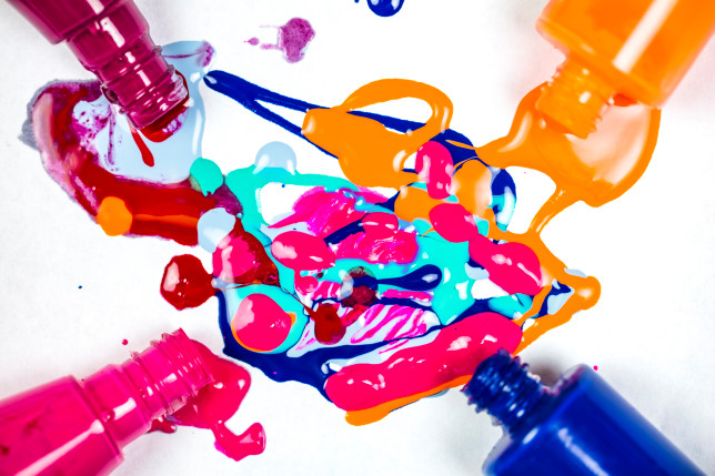 Nail varnish spilling onto white background. Abstract Background