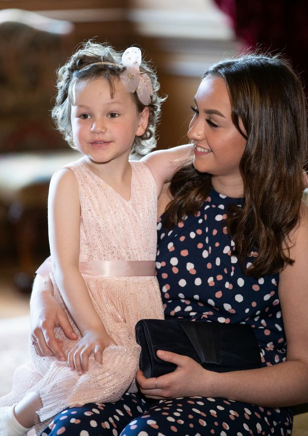 Mila Sneddon, aged five, with her sister Jodi Sneddon, after meeting Catherine, Duchess of Cambridge at the Palace of Holyroodhouse on May 27, 2021 in Edinburgh