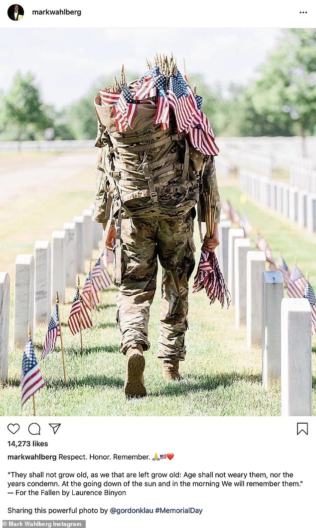 Powerful image:Mark Wahlberg shared a photo of a soldier putting flags on graves as he said: 'Respect. Honor. Remember. ❤️ They shall not grow old, as we that are left grow old: Age shall not weary them, nor the years condemn. At the going down of the sun and in the morning We will remember them. — For the Fallen by Laurence Binyon'