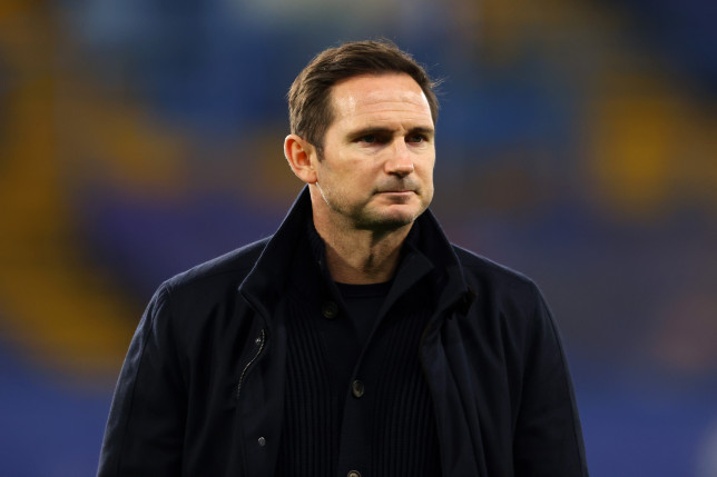 Frank Lampard frowns at a football ground.